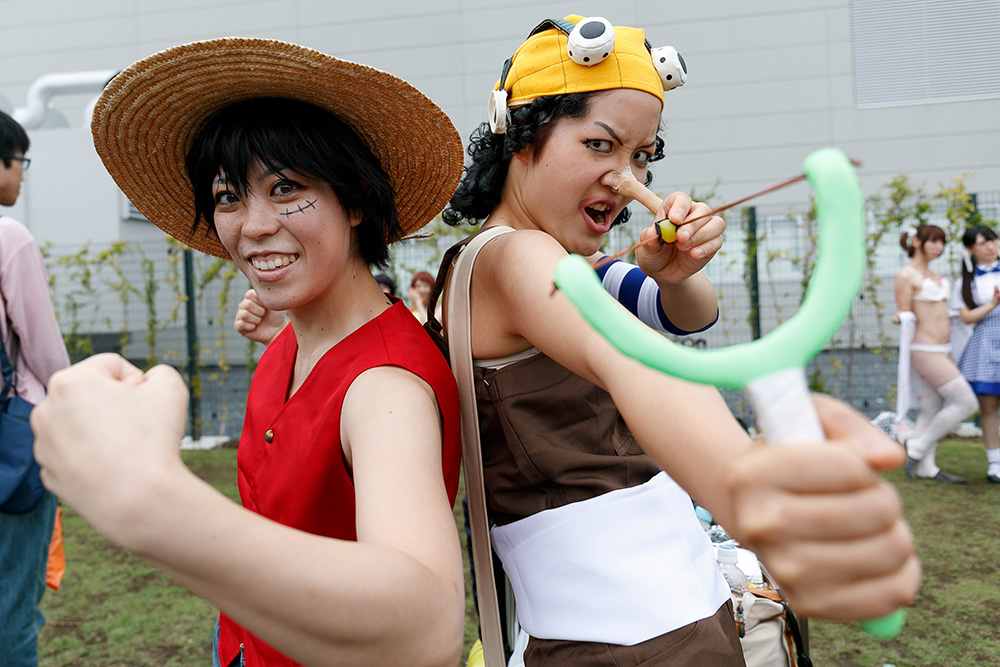 Japan Stock photo of Cosplayers pose for a photograph during the first day of Comic Market 92